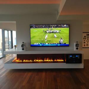 Big screen TV over fireplace